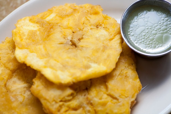 tostones from la romana, served with a green sauce