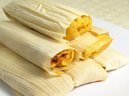 belize tamales/bollos stacked on each other