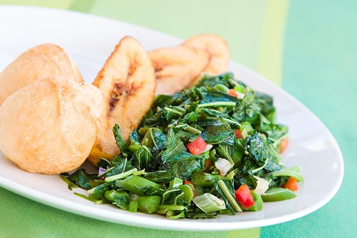 callaloo served with plantains and dumplings