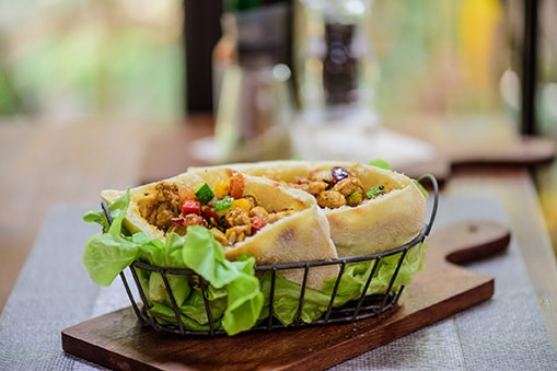 chicken roti from tortola served in a small basket