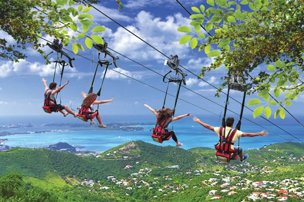 four friends going down flying dutchman, the steepest zip line in the world