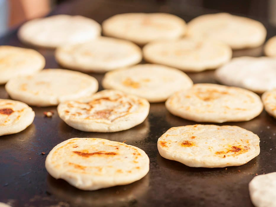 pupusas cooked on a griddle grill in mahogany bay