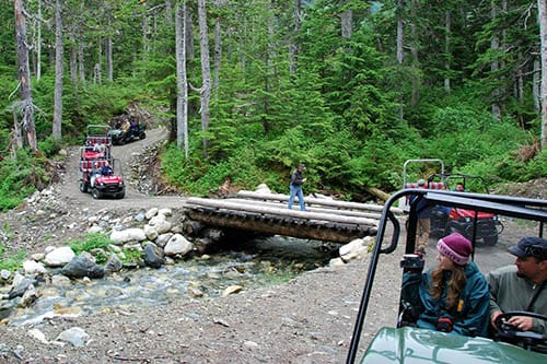 group of people exploring takshanuk mountain trail in skagway on 4x4