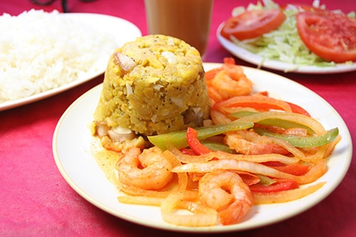 puerto rican mofongo served with shrimp and sliced peppers