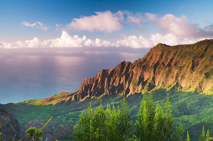 aerial view of kauai mountains in hawaii during the sunset