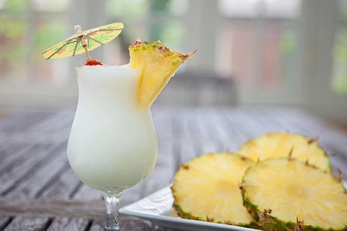 pina colada served with sliced pineapple