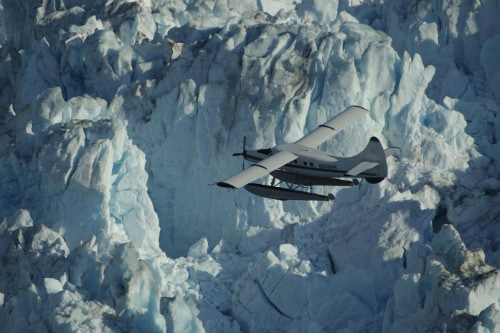 seaplane flying near breathtaking glacier in alaska