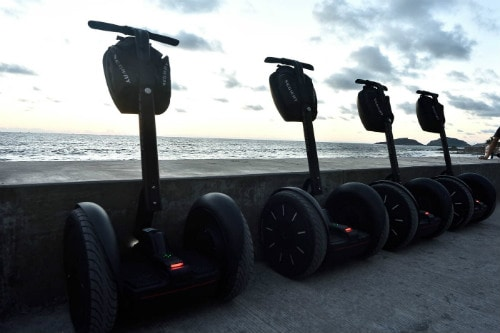 four segways parked in front of the beach in mazatlan mexico