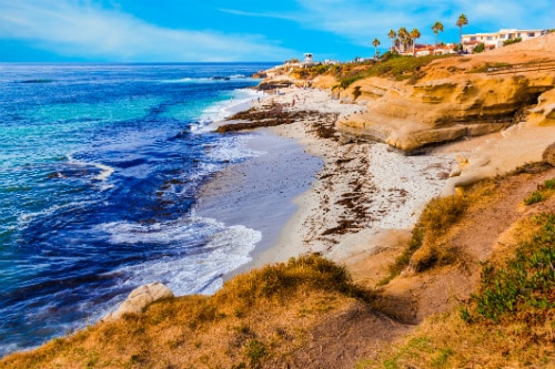 aerial view of beach and cliffs along la jova cove in san diego
