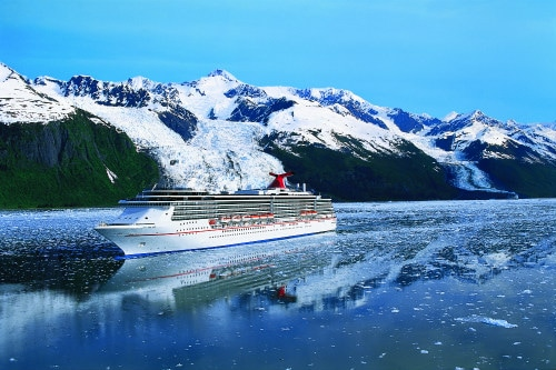 carnival splendor sailing through the snowcapped mountains of alaska