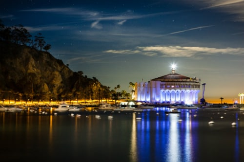 view of the catalina island casino at night from across the avalon bay