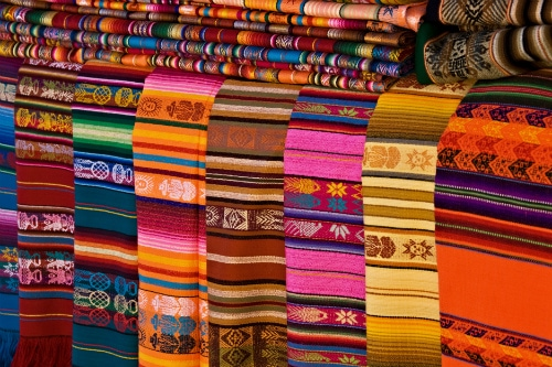 Traditional Mexican Textiles Laid Out On A Table For Sale