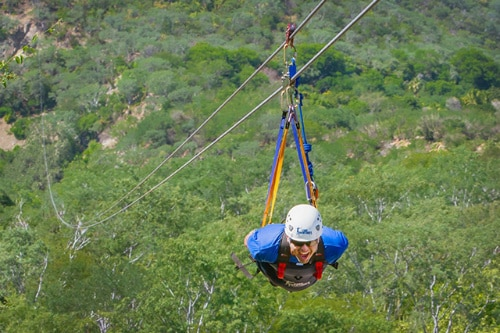 man riding the superman zip line in boca de la sierra