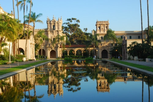 museum buildings reflected on lily pond in balboa park