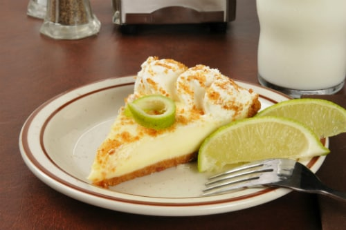 slice of key lime pie from key west served with lime and a sprinkle of breadcrumbs