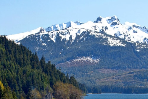 view of the snowcapped mountain range from icy strait point alaska