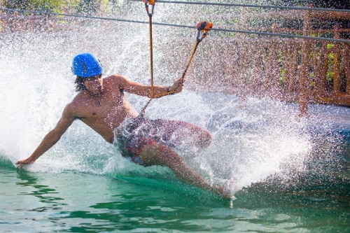 man surfing over the waters in maya lost mayan kingdom adventure park with no board