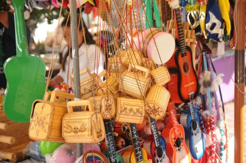 wide variety of souvenirs in ensenada mexico including mini guitars and wooden bags