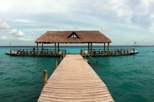 wooden deck built over the seven colors lagoon in costa maya