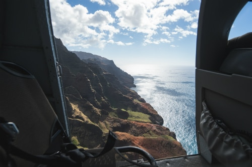 aerial view of the waimea canyon in kauai from the back seat of a helicopter