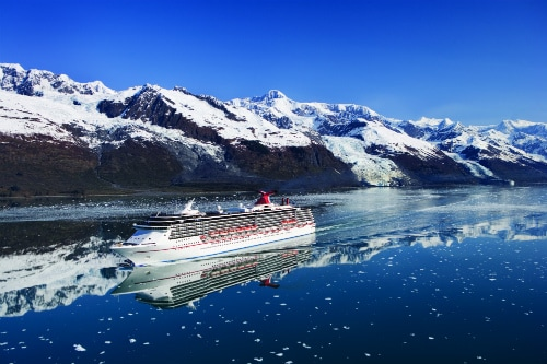 carnival splendor cruising past snowcapped mountains to alaska