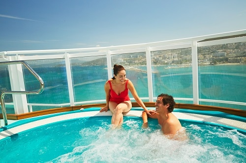 couple enjoying the jacuzzi in serenity adults only retreat with an amazing view of the caribbean