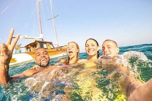 friends taking a selfie as the swim in the ocean off the coast of cozumel