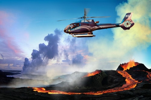 blue helicopter safely flying over the volcanic lava in hilo hawaii