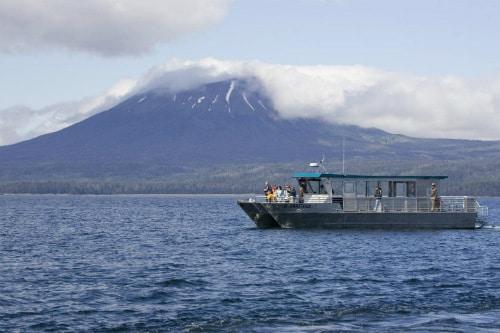 jet-cat catamaran crossing the alaskan waters, headed towards a remote island