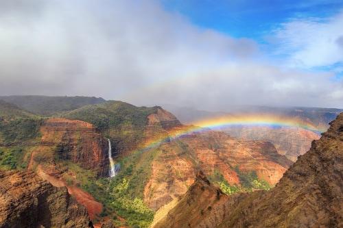 aerial view of a beautiful rainbow over the amazing waimea canyon