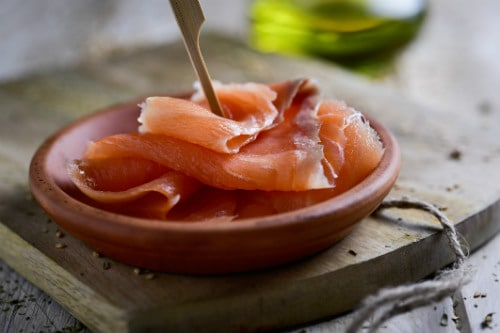 sliced smoked salmon served on an orange bowl