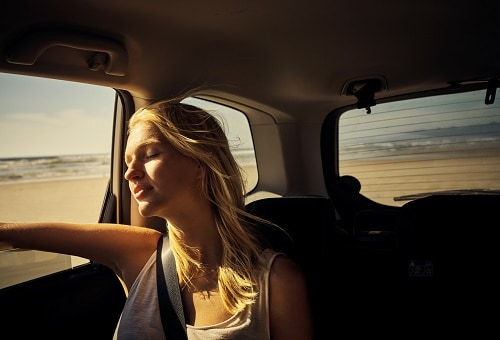 woman looking out the window during her private van trip