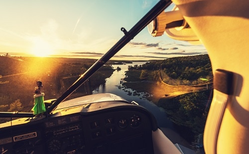 view of the alaskan landscape from a seaplane during the sun set