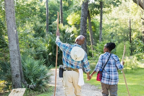 older couple hiking along the nature trails in jacksonville