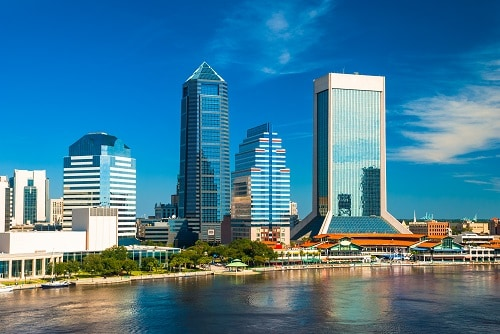 view of the jacksonville skyline from across the river on a sunny day