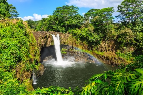 aerial view of the amazing hilo waterfalls in hawaii during a bright sunny day