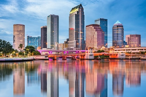 view of tampa skyline from across the bay during the sunset