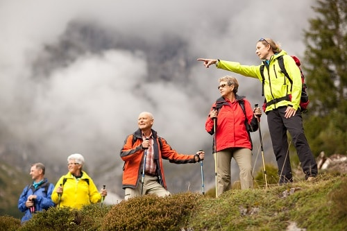 tour guide pointing at the amazing alaskan views during a shore excursion