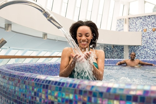 woman pouring water in the thalassotherapy pool from cloud 9 spa