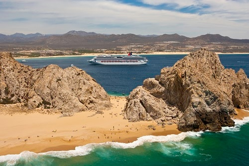 carnival splendor sailing past a popular beach in cabo san lucas mexico