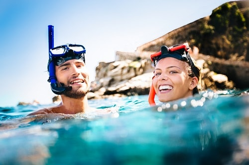 couple getting fresh air as they snorkel in hawaii