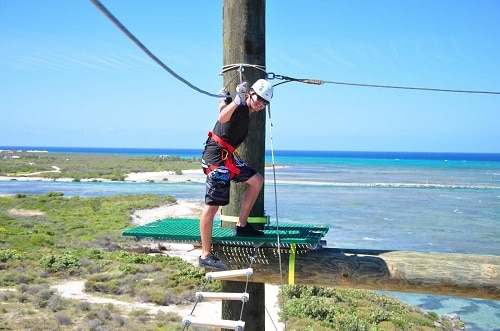 man crossing a ropes course in grand turk