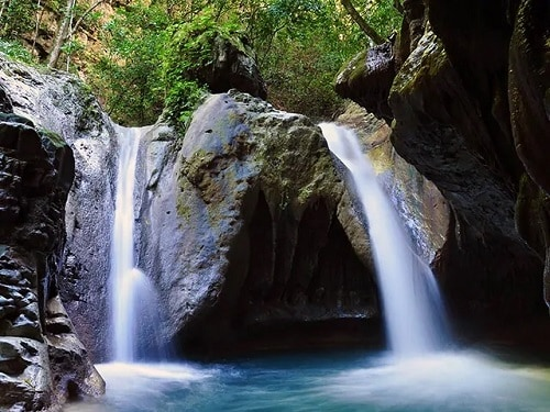 secluded damajagua waterfalls in amber cove dominican republic