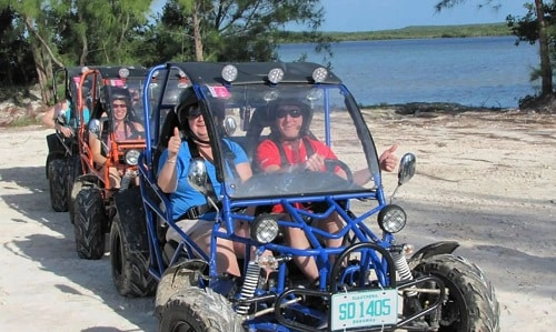 group of visitors exploring princess cays on dune buggies