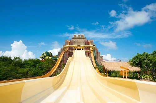 large, yellow slide at the maya adventure park in costa maya mexico
