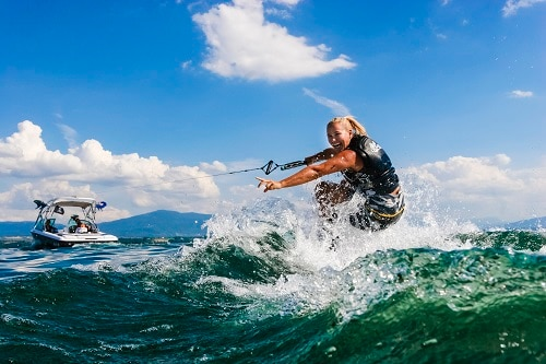 woman water skiing in hawaii with one hand