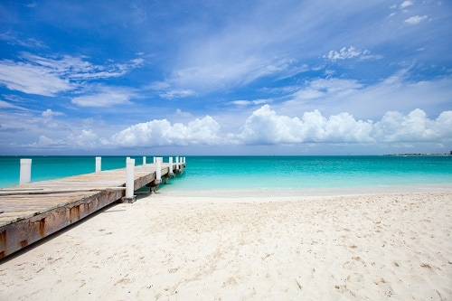 wooden pier in beautiful freeport beach in the bahamas