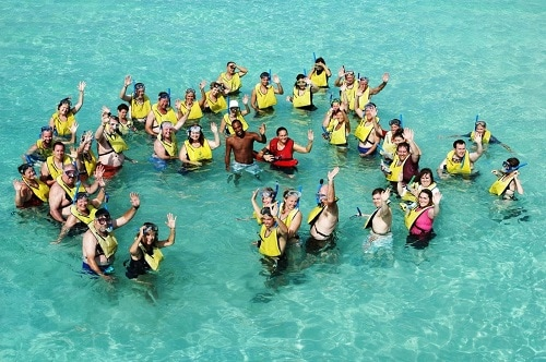 group of people waving before snorkeling in bermuda