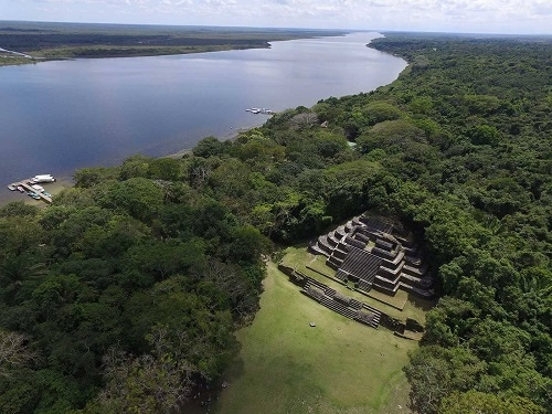 aerial of lamanai mayan ruins and the new river lagoon