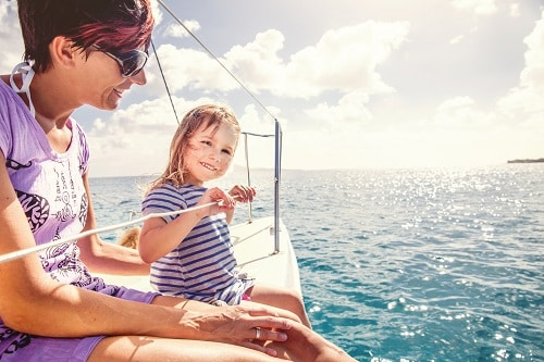 mother and her daughter enjoying a catamaran sail in nassau bahamas
